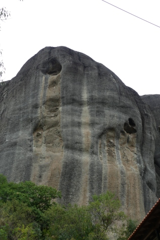 Meteora, rain water seeps through the top of the rocks and finds its way out through faults creating caves