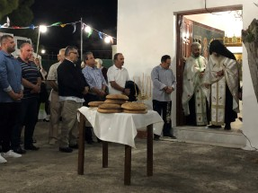 Blessing the communion bread at Pefkos festival