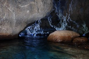 Swimming through the cave at Lindos